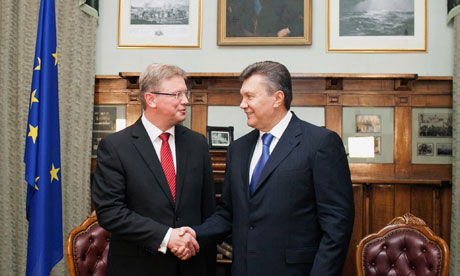 The Ukrainian president, Viktor Yanukovych, and commissioner for enlargement and European neighbourhood policy, Stefan Fule, shake hands. Photograph: Andrei Mosienko/AFP/Getty Images